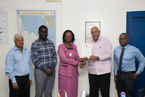 Head of the Conformity Assessment Department, GNBS, Rodlyn Semple presents certificate to GWI's Managing Director, Dr. Richard Van West-Charles surrounded by Director of Corporate Services, Nigel Niles [right], Head of Water Quality, GWI, Deon Moore [second left] and Laboratory Consultant, GWI, Dr. Karamchand Ramoutar [left]