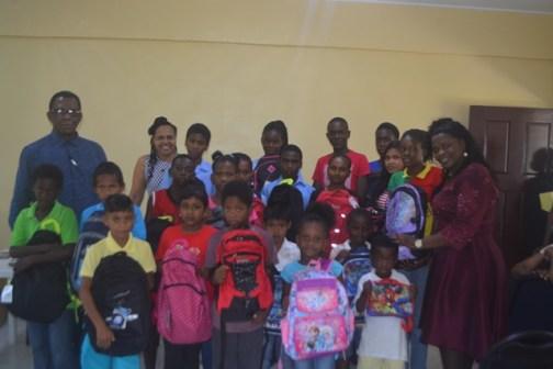 Recipients of school items in Region Four.