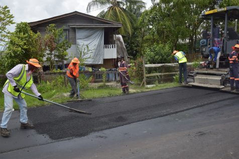 Asphalt being placed on a section of the Canal Number Two road