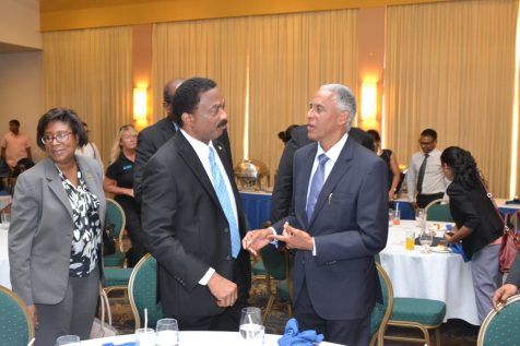 Attorney General and Minister of Legal Affairs, Basil Williams SC., interacting with President of the Caribbean Court of Justice (CCJ), Justice Adrian Saunders