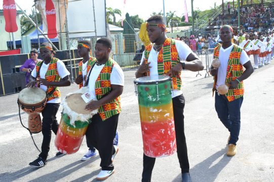 An African Drumming Group performing for spectators