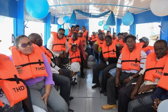 Minister Ferguson and other representatives taking a ride on one of the boats.