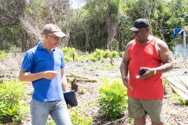 Minister of Business with responsibility for Tourism, Dominic Gaskin interacts with Businessman, Lewis Robinson at the White Cliff Destination site