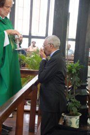 President David Granger breaks bread during communion