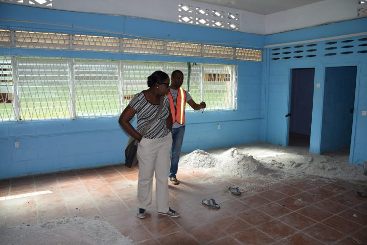 Minister of Education, Nicolette Henry and Special Projects Officer, Ron Eastman examining one of the buildings at Tucville Secondary
