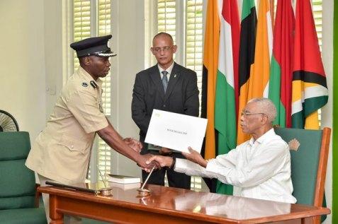 Commissioner Leslie James receives his credential from President David Granger.