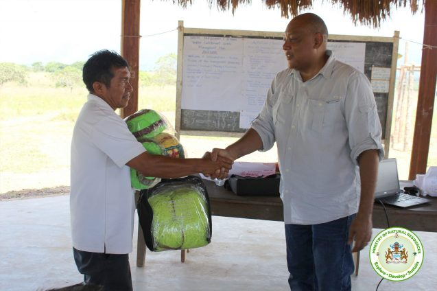 Donation of footballs with nets by Minister Trotman