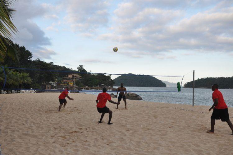 Head Coach Michael Johnson and staff enjoying some head tennis on the beach.