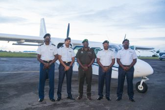 Chief of Staff of the GDF, Brigadier Patrick West [centre], Commander of the Air Corps, Lieutenant Colonel Courtney Byrne [second right] and Major Mohinder Ramjag, Officer in Command at the Flight Operations Department [second left] among other GDF officials pose in front one of the Islanders