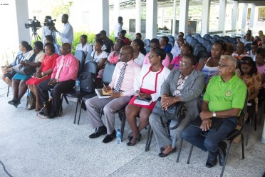 Teachers and parents at the meeting at Queen's College.
