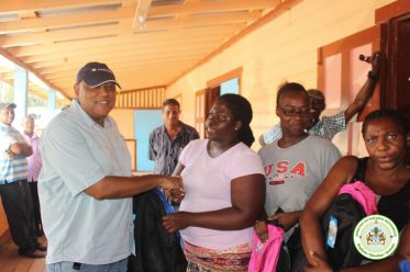 Club staff receiving school supplies