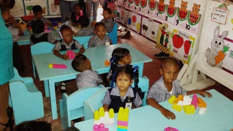 Students of the Cotton Field Nursery School getting settled for their first day.