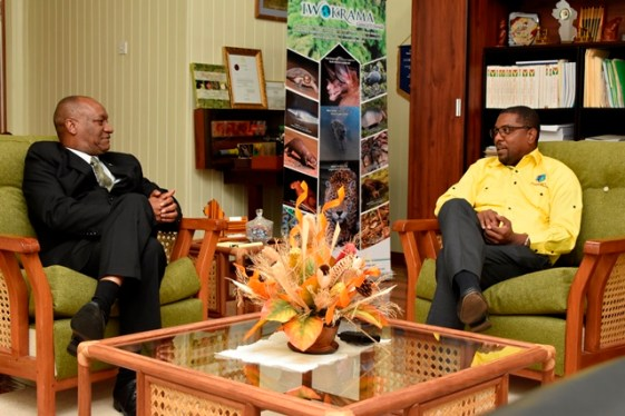 Minister of State, Mr. Joseph Harmon shares a light moment with Mr. Dave Cameron, President of Cricket West Indies.