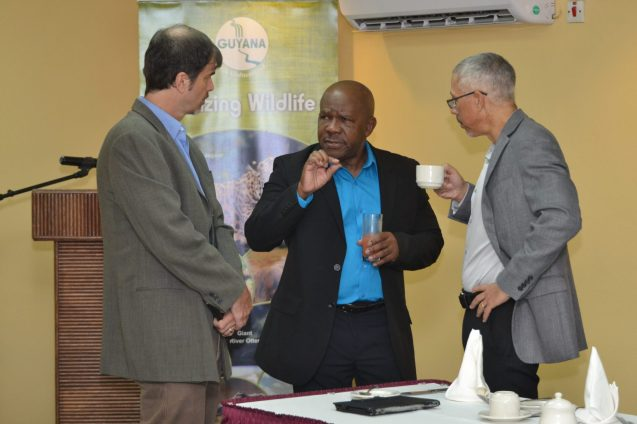 Minister of Business with responsibility for Tourism, Dominic Gaskin engages Guyana Tourism Authority (GTA), Director Brian Mullis and Director General of the Department of Tourism, Donald Sinclair at the breakfast meeting with senior editors