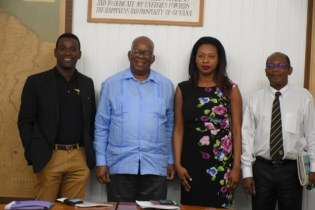 Minister of Finance Winston Jordan (left) with African Business Roundtable (ABR) Executives.