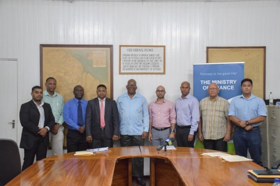 Minister of Finance Winston Jordan (centre) with GCCI Executives.