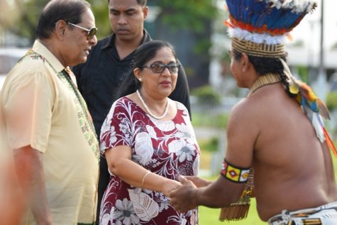 Prime Minister, Moses Nagamootoo and Wife Mrs. Sita Nagamootoo being greeted by an Indigenous Leader.