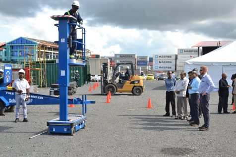 Prime Minister Moses Nagamootoo and Lars Mangal, CEO of TOTALTEC along with other officials observing a demonstration at the facilities