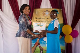 The Ministry of Social Cohesion, Coordinator, Sharon Patterson handed over the gift certificate to Shania Jordan