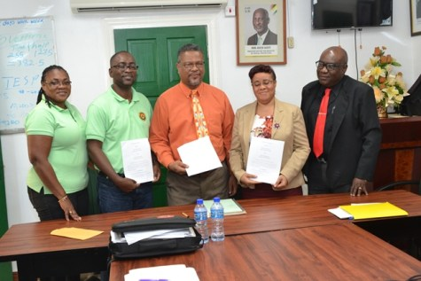 Officials from the Ministry of Education and Guyana Teachers Union earlier today following the meeting.