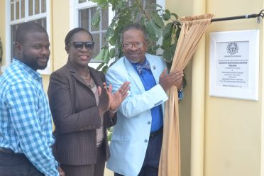 Minister of Education, Nicolette Henry and University of Guyana's Vice-Chancellor, Professor Ivelaw Griffith unveiling a plaque to commission the Facilities Maintenance Division at the University's Turkeyen campus