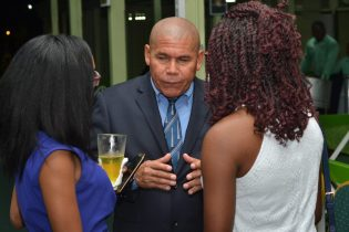 Minister of Social Cohesion, Dr. George Norton interacting with the young people who will be participating in the inaugural National Youth Conference