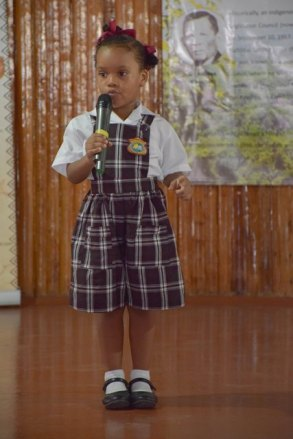 Fola Cadogan, a student of Anais Private School performing a poem.