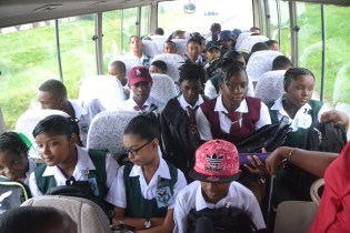 Students from various schools in Region Three riding in the David G school bus on their first day of school.