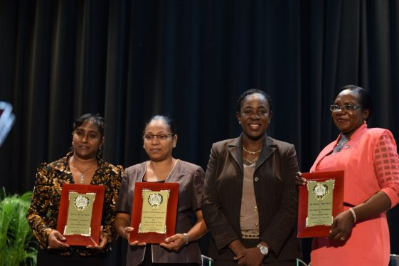 Minister of Education, Nicolette Henry [second from right] flanked by headteachers of schools receiving awards for highest attendance for the year 2017 to 2018