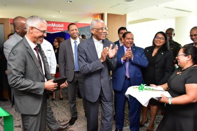 President David Granger shares a light moment with Prime Minister Moses Nagamootoo and Minister of Business Mr. DominicGaskin after the cutting of the ribbon to open GuyTIE.