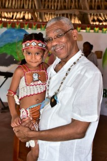 President David Granger takes a photograph with little Anna Vieira after declaring the Rupununi Regional Heritage celebration 2018.