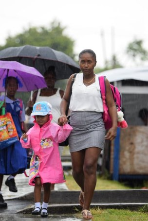 This mother braved the weather as she takes her youngster to school.