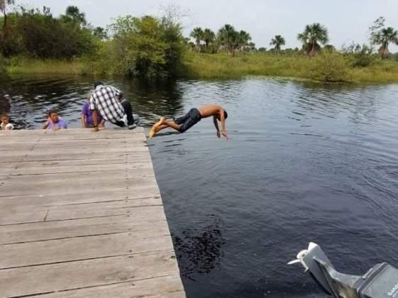 Taking a dip in the Kamuni Creek.