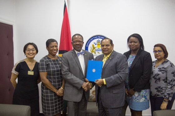 Prime Minister Moses Nagamootoo, UG's Vice-Chancellor, Professor Ivelaw Griffith during the handing over, UG's Deputy Vice-Chancellor, Planning and International Engagement, Dr. Barbara Reynolds, United Nations (UN) Resident Representative to Guyana, Mikiko Tanaka and staff of the OPM are also pictured.