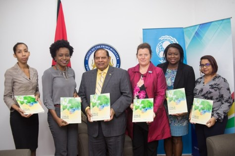 Prime Minister Moses Nagamootoo and UNICEF's Permanent Representative to Guyana, Sylvie Fouet during the release of the report pictured with staff of the two offices.