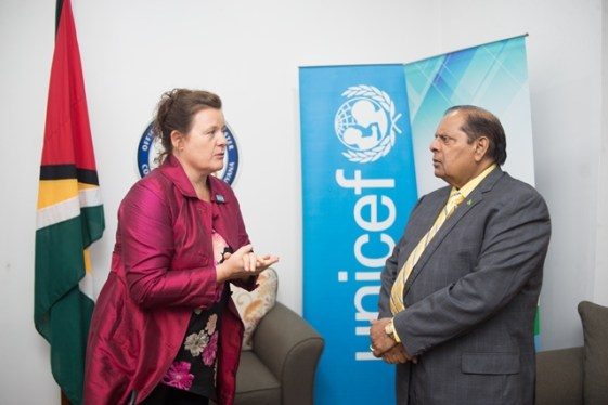 Prime Minister Moses Nagamootoo and UNICEF's Permanent Representative to Guyana, Sylvie Fouet engaged in conversation.