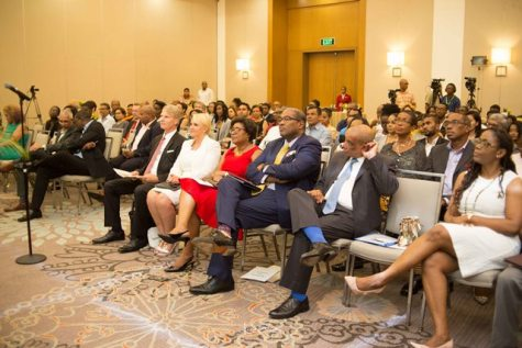 Managing Partner of the law firm, Attorney-at-Law, Nigel Hughes and wife Mrs. Cathy Hughes - the Minister of Public Telecommunications - seated in the audience at the at the launch of the Hughes, Fields and Stoby USA PLLC in Houston, Texas at the Guyana Marriott Hotel.