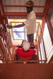 One of the residents of the Palms Geriatric Home using the lift.