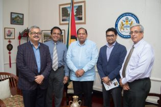 Prime Minister Moses Nagamootoo along with Dr. Ajeenkya Patil, Guyana's Honorary Consul in Mumbai, India and his team