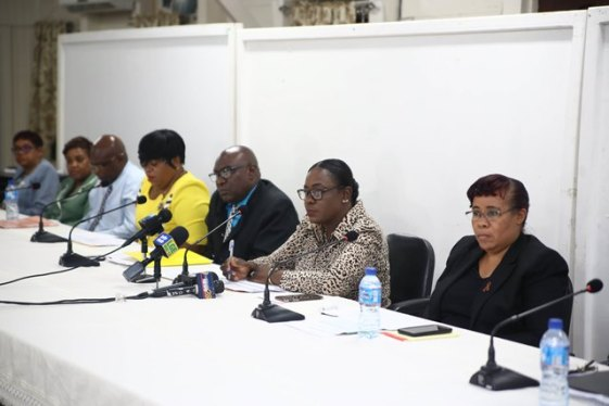 Minister of Education, Nicolette Henry and other officials of the Ministry of Education speaking to the media.