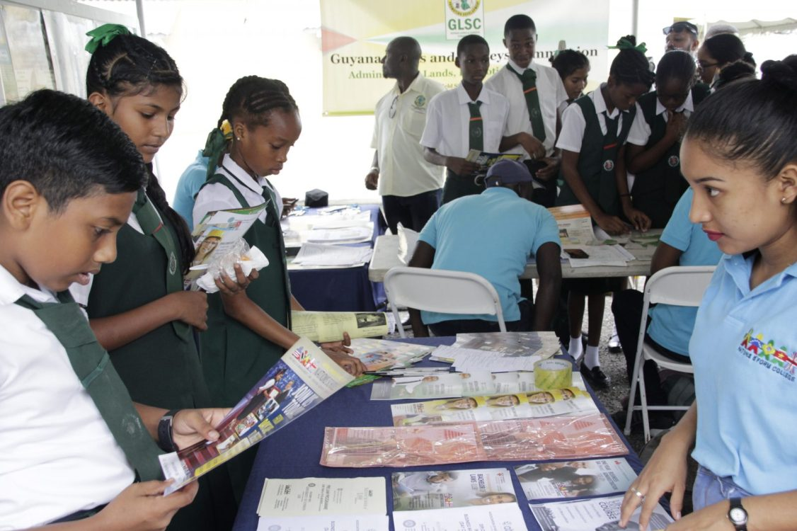 Students engaging a representative of Nations Schools at the Career Fair