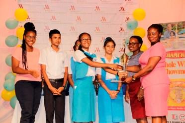 Members of St. Joseph High School receiving the winning trophy from Coordinator, Ms. Stacy Osborne.