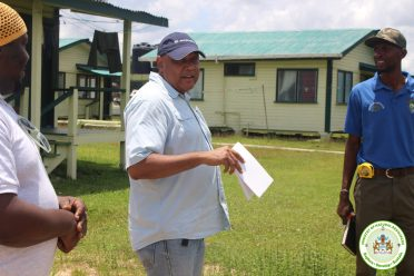 Minister engages with forest station staff during an inspection of their surroundings