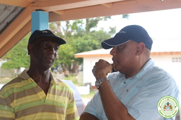 Minister speaks with Region 10 Vice chairman Elroy Adolph