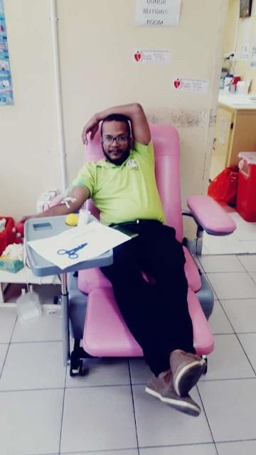 RHO Dr. Dudhnath donating blood.
