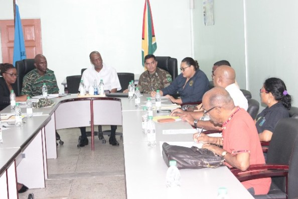 State Minister Joseph Harmon meeting during a meeting at CDC today.