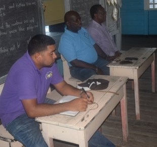 [In the photo, from left to right] Officials at the meeting: Hemchand Naraine, Project Engineer, CDF Director, Lennox Forte and CDF Programme Specialist, Errol Bobb.