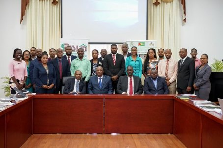 Minister of State, Mr. Joseph Harmon (seated second left) and Commissioner and Chief Executive Officer (CEO) of the GLSC, Mr. Trevor Benn (seated second right) with participants of the capacity building workshop for Negotiating within the Organs of the United Nations Convention to Combat Desertification (UNCCD).