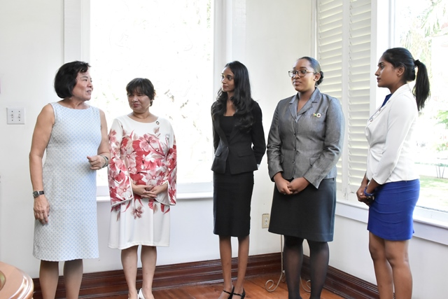 First Lady, Mrs. Sandra Granger (left) in discussion with (from second left) Canadian High Commissioner to Guyana, Ms. Lilian Chatterjee, President for the Day, Ms. Renuka Persaud, Prime Minister for the Day, Ms. Delicia George and Canadian High Commissioner for the Day, Ms. Sara Mohan as she welcomes them to State House.