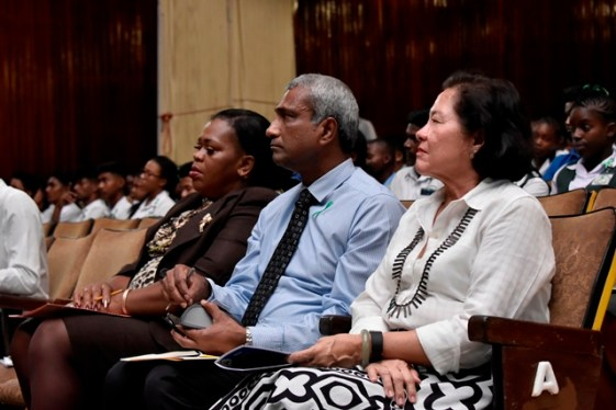 First Lady, Mrs. Sandra Granger (first right), along with CEO of Massy Distribution (Guyana) Incorporated, Mr. Navin Thakur and Regional Education Officer, Region Ten, Ms. Marcia Paddy-Andrews (second and third from right) pay keen attention to the performance.
